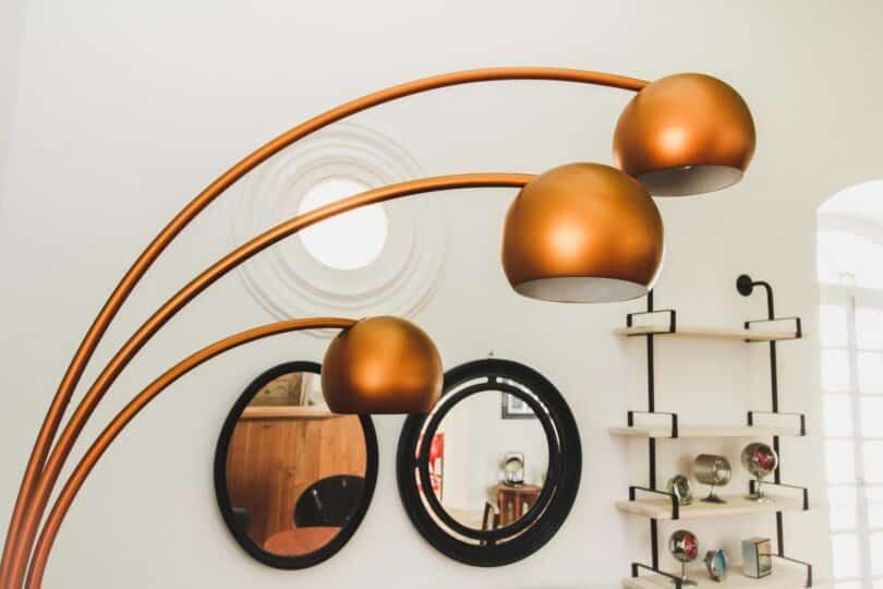 brass-colored 3-light floor lamp inside room